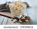 Popcorn In Glass Bowl Over...