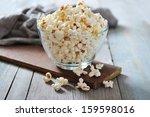 Popcorn In Glass Bowl Over...