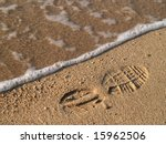 Shoe Print In Wet Sand With Wave