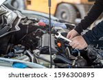 Hand of mechanic man hold spanner tool, inspection and maintenance car service - stock photo