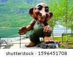 Small photo of GEIRANGER, NORWAY - MAY 22, 2019: Troll monument in Geiranger, Norway. Troll is a class of being in Norse mythology and Scandinavian folklore. Trolls may look and behave exactly like human beings.