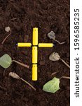 Small photo of Yellow batteries in the form of a cross in the soil with wilted dying plants, leaves. Environmental damage and pollution. Land contamination and destruction. Subsequent proper recycling and disposal.