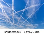 contrails over blue sky.