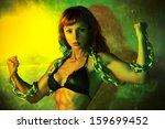 Young sports woman with heavy chain. Vibrant green colors. - stock photo
