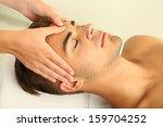 man having head massage close up   Shutterstock . vector #159704252
