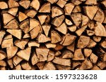 Firewood Stacked Near The Wall...