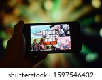 Kuala Lumpur, Malaysia. 25 December 2019 - Close up of Grand Theft Auto Online image game on smartphone display with bokeh background. - stock photo