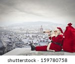 Santa Claus Sitting Over The...