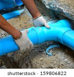 Workers Are Water Pipes With...