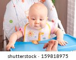 little baby feeding with a... | Shutterstock . vector #159818975