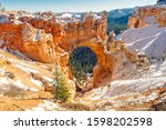 Natural Stone Bridge, Arch at Bryce Canyon with snow
