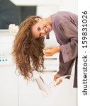 Smiling Young Woman Blow Dryin...