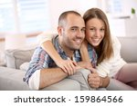 sweet couple sitting in sofa at ... | Shutterstock . vector #159864566
