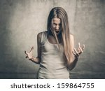 blonde girl shouts | Shutterstock . vector #159864755