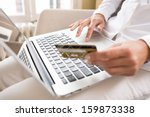 woman's hands holding a credit... | Shutterstock . vector #159873338
