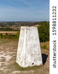 Small photo of TOTTERNHOE, BEDFORDSHIRE, UK - SEPTEMBER 14, 2019: A triangulation station, or pillar, sits atop the knoll where a medieval castle once stood, with just the land works remaining.