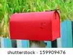 Red Mail Box On Wooden Wall