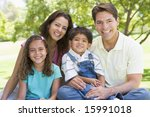 family sitting outdoors smiling | Shutterstock . vector #15991018