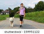 Stock photo little girl taking a dog for a walk outdoors in nature 159951122