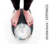 A Girl On A Weighing Scale  On...