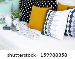 colorful pillows on a sofa with ... | Shutterstock . vector #159988358