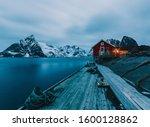 Norway Lofoten Islands Landscape winter mountains red cabins - stock photo