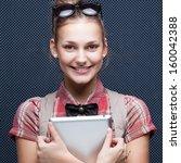 smiling hipster girl holding... | Shutterstock . vector #160042388