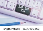 Small photo of Text sign showing Blog Blog Blog. Conceptual photo Internet blogging trend modern virtual communication White pc keyboard with empty note paper above white background key copy space.
