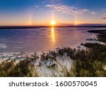 Sunset And Sundogs Over A...
