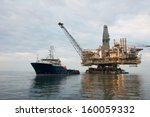 oil rig being tugged in the sea | Shutterstock . vector #160059332