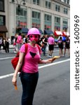 pride parade participant in pink costume - stock photo