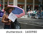 Old gay marching on pride parade - stock photo