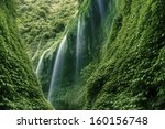 Waterfall In The Deep Forest O...