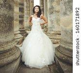 Beautiful Bride Stands Between...
