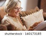 pretty mature woman passing her ... | Shutterstock . vector #160173185