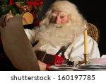 Santa Claus Sitting At Home And ...