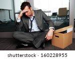 Sad Fired Businessman Sitting...