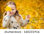 Adorable little girl outdoors at beautiful autumn day - stock photo