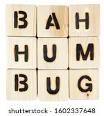 Small photo of BAH HUMBUG sentiment spelled out with toy blocks. Isolated.