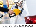 Close Up Pumping Gasoline Fuel...