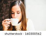 young woman drinking coffee in... | Shutterstock . vector #160300562