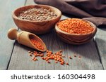 lentils in wooden bowl with... | Shutterstock . vector #160304498