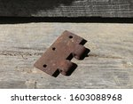 An Old Rusty Hinge Part Rests...