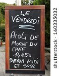Outside menu sign for aioli diner at French restaurant  - stock photo