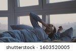 beautiful brunette woman wakes... | Shutterstock . vector #1603520005