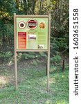 Small photo of KNYSNA, SOUTH AFRICA - MARCH 5, 2016: Information board where the historic Templeton Station stood at the Ysterhoutrug picnic spot in the Knysna Forest. The railway ceased operation in 1949