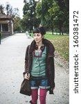 beautiful young woman walking... | Shutterstock . vector #160381472