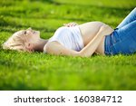 happy pregnant woman in the... | Shutterstock . vector #160384712