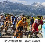Small photo of LA ROCHETTE, FRANCE- JUL 16:The peloton pedaling on a plain road after the ascension to Col de Manse in The Alps during the stage 16 of 100 edition of Le Tour de France on July 16 2013 in La Rochette