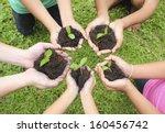 hands holding sapling in soil... | Shutterstock . vector #160456742
